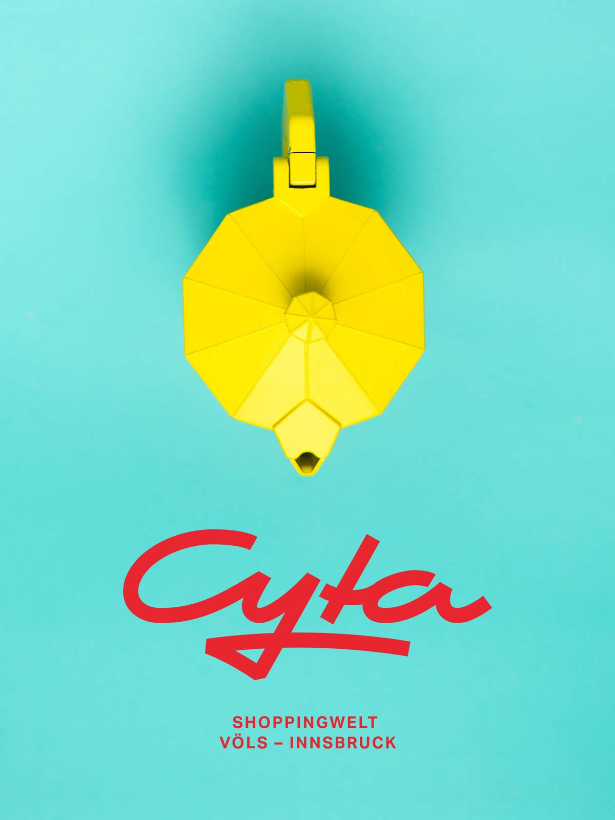 Cyta Shoppingwelt logo on photography of turquoise background with yellow bialetti by Alex Gruber from Unsplash